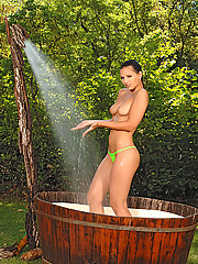 Slender babe Eve Angel posing in bath outdoors showing ass