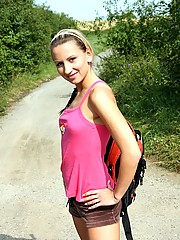 Strolling chick undresses outside on the road