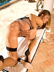 Suzie Carina opens her long legs and plays
