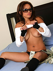 Kyra plays with her dirty money