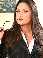 Stephanie Swift slips off her pinstripe suit