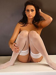 Georgia Jones naked except for stockings