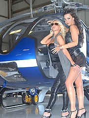 Amazing big tits molly and porn star sophie santi fuck eachother on a helicopter in these hot lesbo fucking pics and big movie
