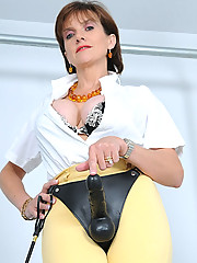 Stunning mature strapon dominatrix