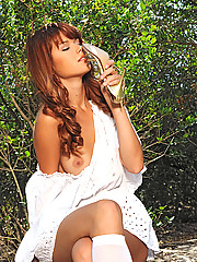 Hot Kami strips outdoors showing her beautiful legs naked