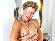 Pretty milf with tiny tits rubs her hairy twat and spreads it wide