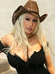 """Blonde Gina Lynn strips out of cowgirl clothes in this hot photo set"""