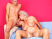 Busty grandma sucks cock and gets fucked by a young man