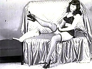 Classic star Betty page showing her sexy black stockings