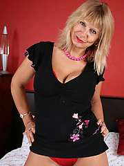 Naughty cougar Alex pinches her big jugs and spreads her pink pussy really wide