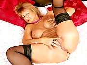 Tan milf with big natural tits fingers her fuck box at Anilos