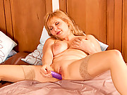 Red head with huge tits masturbates with a dildo at Anilos
