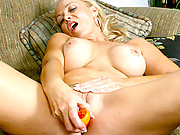 Blonde cougar with huge tits masturbates with a dildo