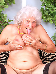 Busty Anilos granny sucks her fingers and dips them deep within her needy hairy hole