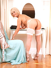 Enticing busty blonde Anilos displays her curvy cougar body in the nude
