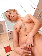 Blonde Anilos Samantha White gets horny as she fondles her mature pussy on top of the kitchen counter