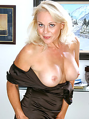Totally naked blonde milf loves to fondle her pink mature snatch while lying on a carpeted floor