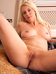 Naughty cougar slides off her sexy thongs while spreading her sweet pink pussy