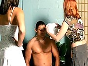 A naked man gets humiliated by clothed women here