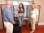 Two clothed girls strip this guy down to play with him