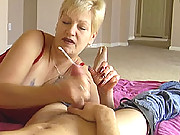 This amateur granny Debbie is one horny freak...but when the sight of a massive erect cock she gets even hornier. Watch Debbie get cum blasted as she tugs and milks a big cock. You can tell she is geting worked up as she begins to play with her wet drippi