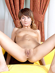 Horny amateur Jilana spreading her pink Nubile pussy strips as she gets totally naked and on the sofa