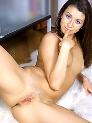 Nubile Nadyenka spreads her super pink pussy lips on top of her white fur coat on the living room floor
