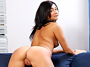 Short Latina fingers her shaved pussy on the couch