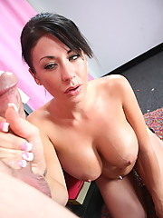 Busty whore Isis Monroe in the living room giving out a handjob