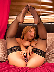 Horny Anilos Leona Lee really loves her toy and spreads her pink pussy on the bed