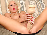 Kasey stuffing her pussy with a huge dildo!