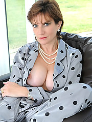 Mature in silk pyjamas masturbating