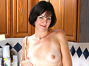 Mature housewife masturbates with the hose in the kitchen sink