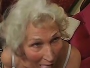 Grey haired granny gumming cock