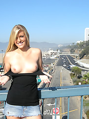 Blond exposing her tits and ass in public