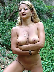 Curvy blonde nudist in the forest