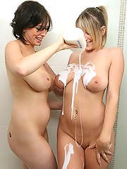 Busty babes soap up in the shower