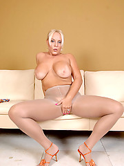 Massive titted Anilos peels off her pantyhose and indulges in pussy play time with sexy toys