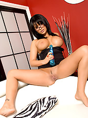 Eva Angelina dildo plays in the living room while wearing a hot little black dress