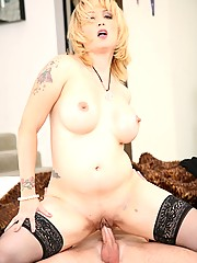 Sexy blonde milf with big tits and a big ass enjoys getting fucked by a young virgin