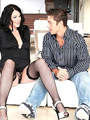 Six foot tall and stacked brunette milf spreads her long legs open to let a younger man fuck her