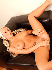 Busty babe Brandy Blair stuffs her tight pussy with a orange dildo vibrator