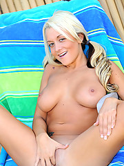Busty blonde Brandy Blair has fun exposes her body outdoors