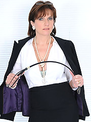Business suited busty mature domina