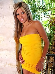 Kristin shows us whats underneath that yellow dress she is wearing