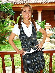 Tania is a naughty schoolgirl that strips off her uniform and has some fun