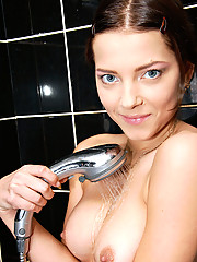 Nubile Anina fucks the dildo inside her still wet pussy after a wild shower