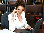 Busty secretary strips in the office and masturbates