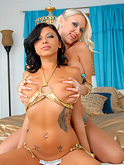 Watch these 2 hot micro shiny bikini babes share their hot fucking boxes in these strap on fucking lesbo pics