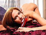 Seductive Latina power bangs her pussy with a red dildo
